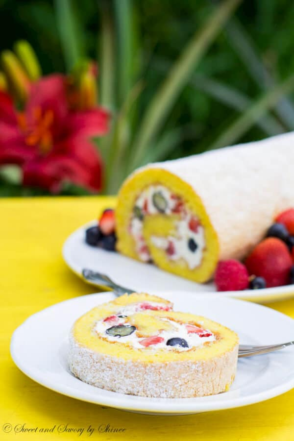 This light and fluffy classic roll cake is loaded with homemade whipped cream and fresh berries! Ultimate summer dessert.