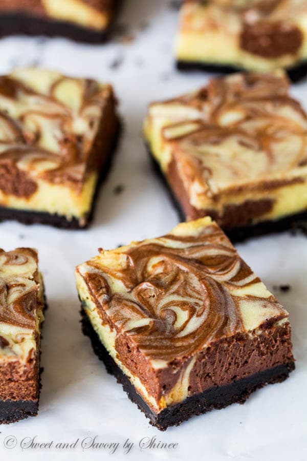 Creamy and rich, these triple chocolate cheesecake bars are such an ...