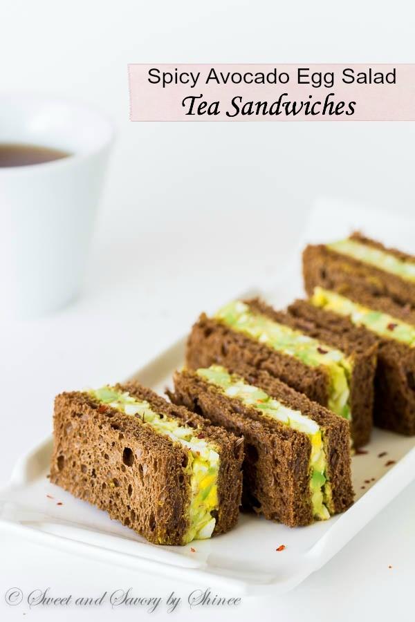 Spicy avocado egg salad sandwiched between chewy pumpernickel bread ...