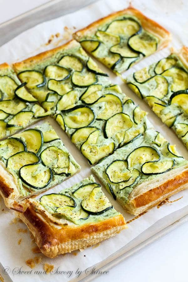 Light and crispy puff pastry smeared with creamy herby ricotta and topped with fresh zucchini slices. Light and satisfying!