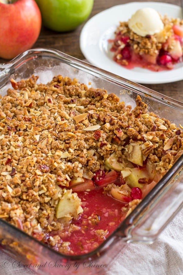 Fall calls for comfort food. And what's better than warm apple cranberry crisp with nutty, crunchy crumbs and sweet n' tart apple cranberry filling?