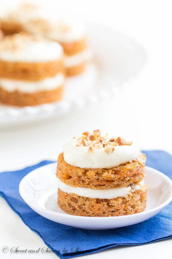 Adorable mini carrot cakes filled with classic cream cheese frosting and studded with crunchy candied pecans! It's the only way to eat carrot cake!