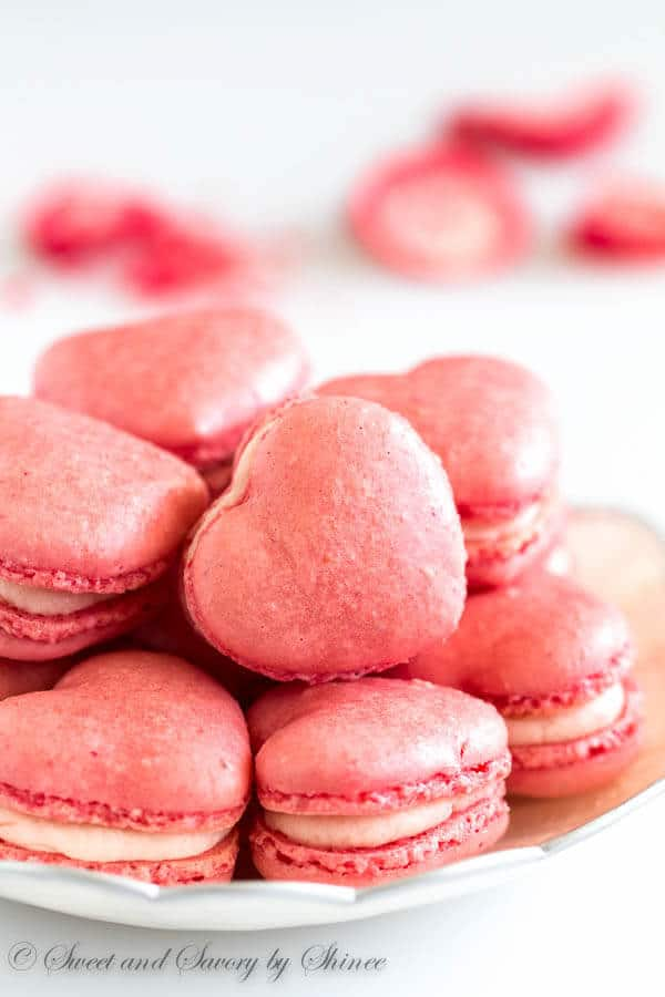 little heart-shaped strawberry macarons are infused with strawberry ...