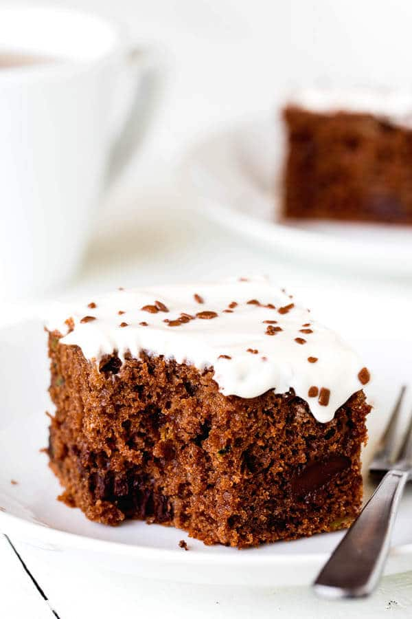 This double chocolate zucchini sheet cake is an effortless way to feed a crowd! No mixer required. Plus, your guests won't even know there's zucchini in the cake!