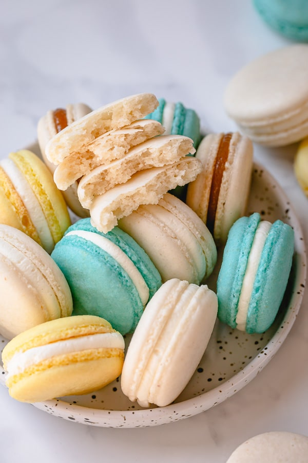 A comprehensive macaron recipe with lots of tips and tricks for perfectly full french macarons. So much helpful information here! #frenchmacarons #macaronrecipe