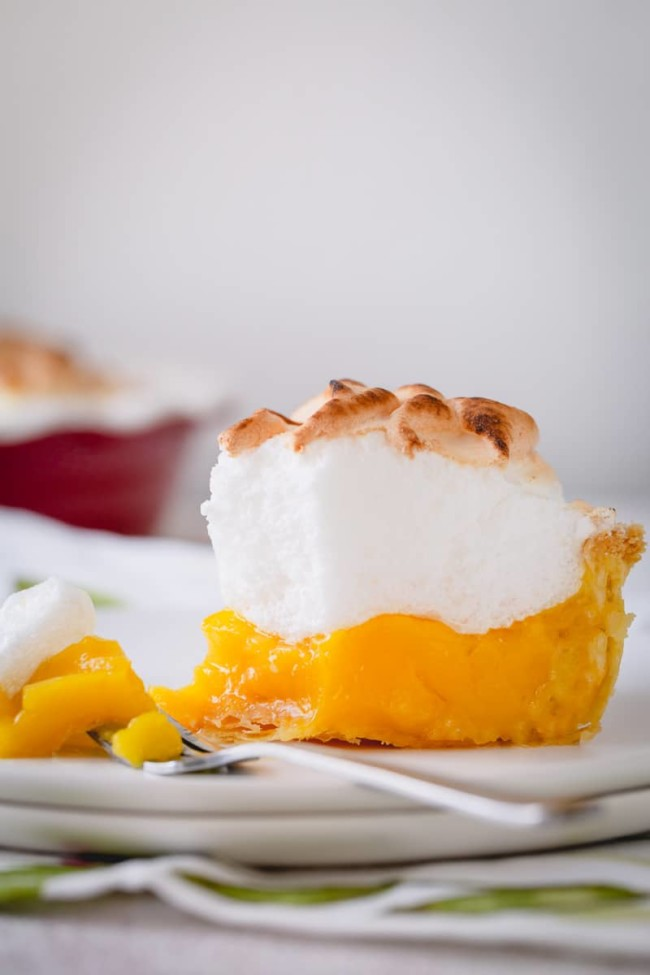 Classic lemon meringue pie recipe with lots of tips and tricks for a perfect pie every time! No more weeping and shrinking. This's the BEST! #lemonmeringuepie