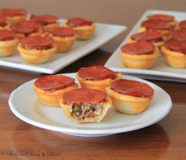 Simple mini pizza tartlets. Perfect appetizer for meat-lovers!