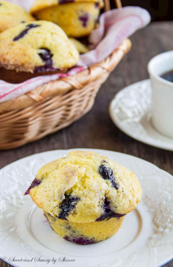 These tall blueberry cheesecake muffins are melt-in-your-mouth-fluffy and loaded with fresh blueberries! Not your usual blueberry muffins here, you've got to try this!