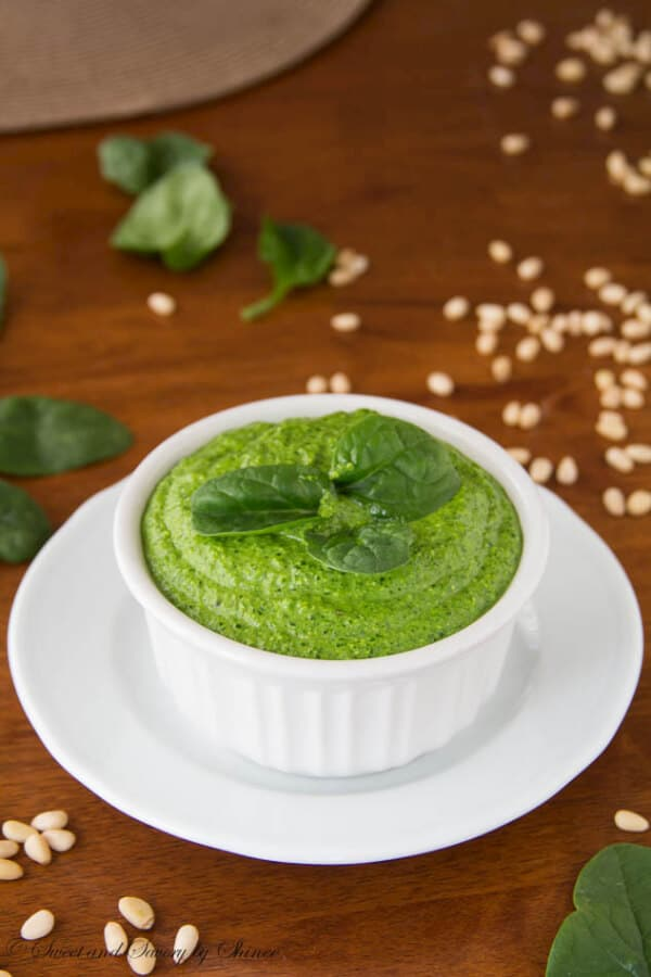 Beautiful bright green spinach pesto will be your best friend for busy week night dinners. Step-by-step photo instructions. | www.sweetandsavorybyshinee.com
