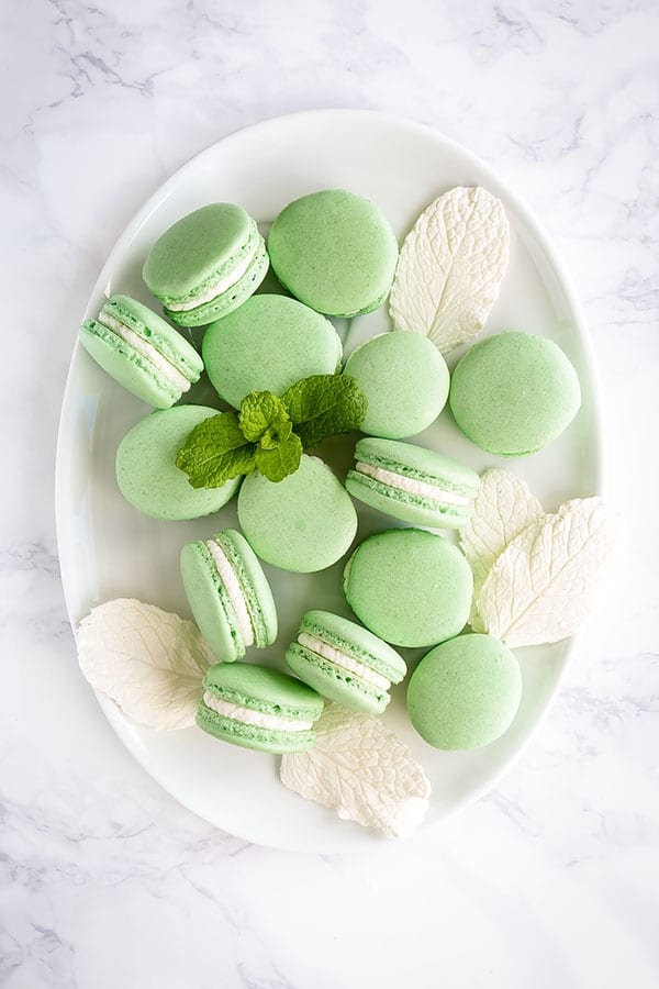 Light and minty these french macarons are such a treat. And you CAN make a perfect batch right at home. #frenchmacarons #macarons #mintmacarons