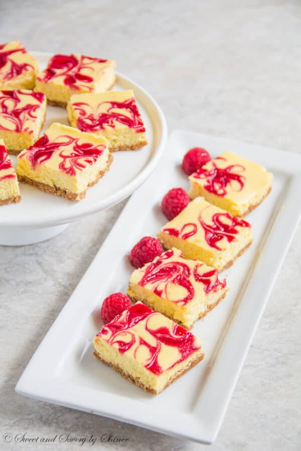 These soufflé-like lemon raspberry cheesecake bars are amazingly creamy and soft with burst of honey-glazed raspberry sauce.