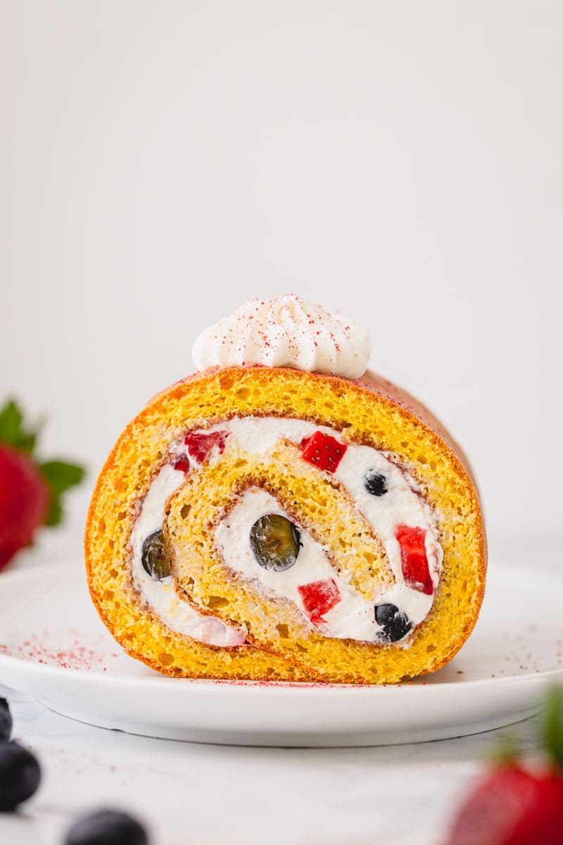 How to make a roll cake, a simpler way. No need to roll the cake while hot, this spring-y sponge cake is super pliable and rolls beautifully without cracks! #rollcake #swissroll