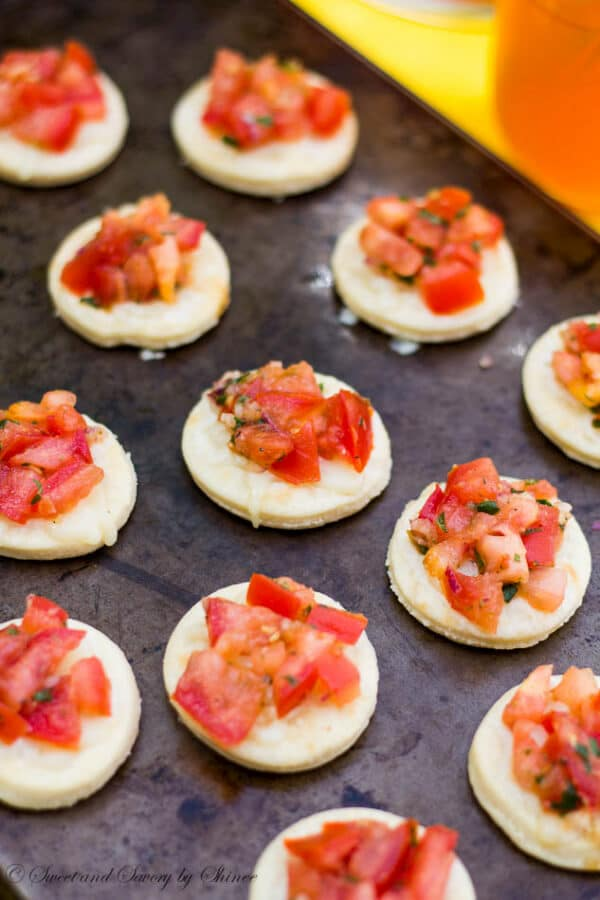 Each bite of this mini bruschetta pizza bursts with flavors from fresh tomatoes to slightly spicy basils, from soft crust to melted mozzarella.