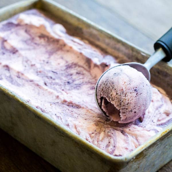 Two flavorful ice creams swirled into one creamy, fruity frozen heaven! Super easy, eggless berry ice cream for you to try this summer.