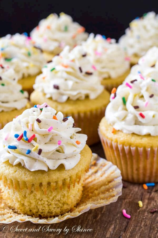 These are deliciously light and soft vanilla bean cupcakes, topped with sky-high silky smooth Swiss meringue buttercream and rainbow of sprinkles, of course!