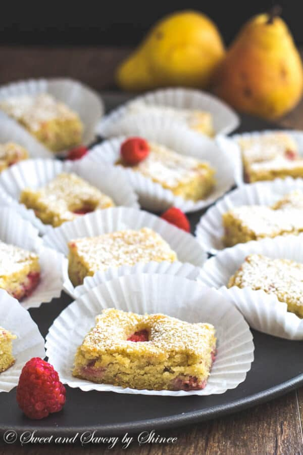 These raspberry pear almond cake bars are light and delicately sweet with slight tanginess of raspberries! Irresistible crowd pleaser!
