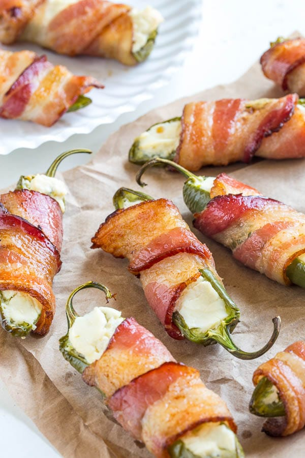 Bacon wrapped jalapeno poppers with just 3 ingredients! Simple, delicious and incredibly addicting snack for any occasion!