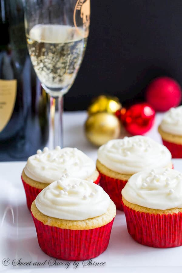 Fluffy white cupcakes with champagne and frosted with tangy champagne buttercream are elegant and delicious treat for New Year's Eve or for any occasion.