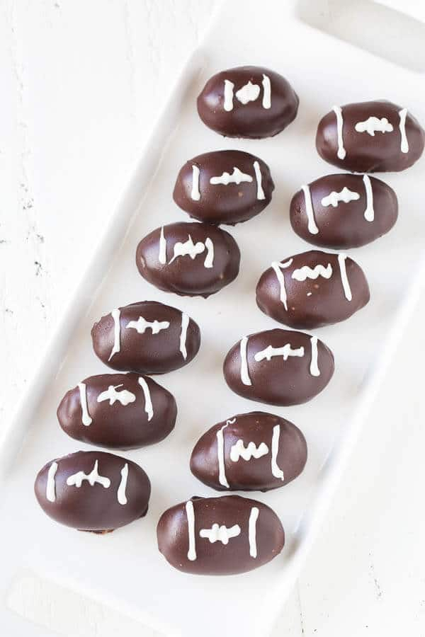 Triple Chocolate OREO Cookie Balls... Bring the game spirit to your dessert table with these triple chocolate OREO cookie balls, dressed as an American football!
