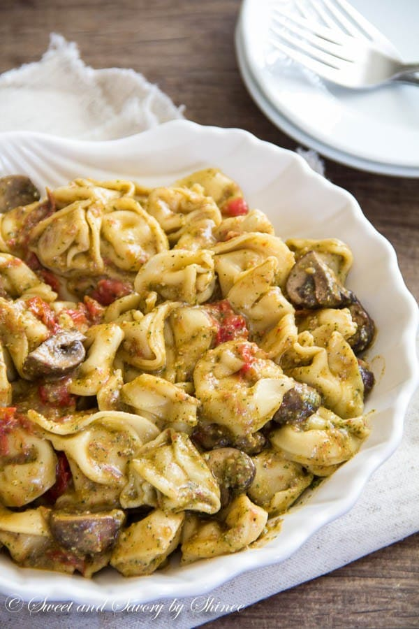 Quick and tasty pesto mushroom tortellini can be served as weeknight dinner, or last minute appetizer. It comes together in under 30 minutes.
