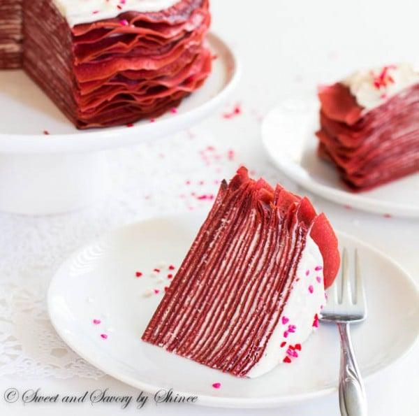 Made with layers of thin red velvet crepes and filled with tangy cream cheese filling, this crepe cake tastes as delicious as it looks! Perfect dessert for Valentine's Day.