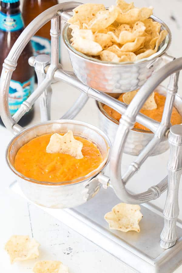 Creamy, cheesy, wonderful! This red chile queso dip is exactly what you want to pair your warm tortilla chips with.