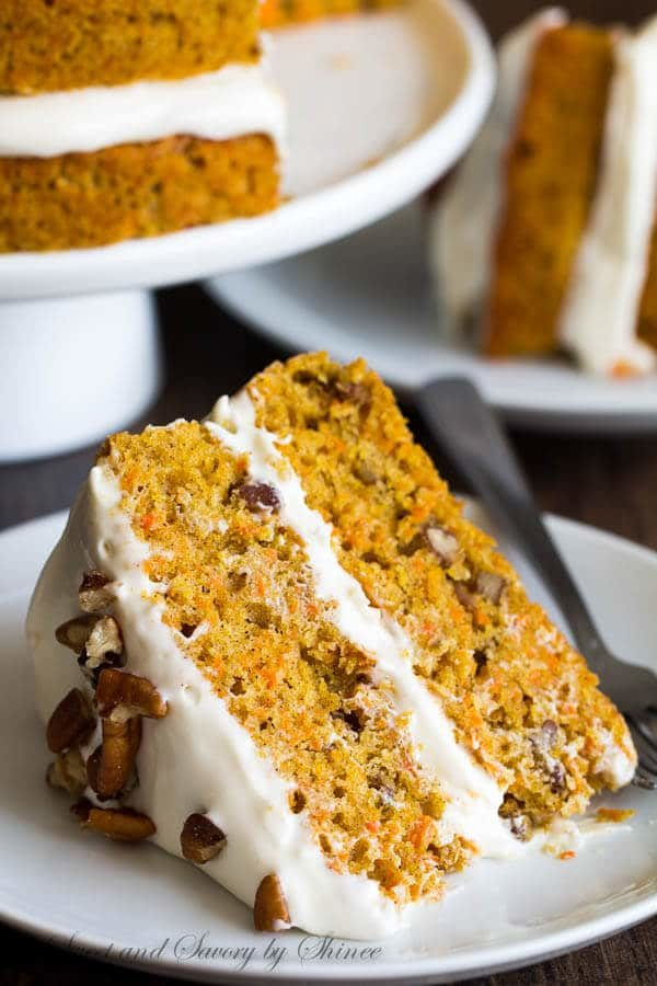 Dense, yet moist carrot cake layers generously smothered with sweet and tangy cream cheese frosting. It's everything you want your layered carrot cake to be.