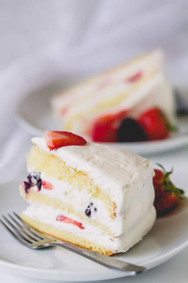 A slice of 3-layer cake on a plate.