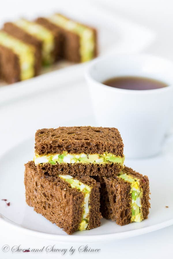 Spicy avocado egg salad sandwiched between chewy pumpernickel bread slices. Perfect texture contrast and flavor combination!