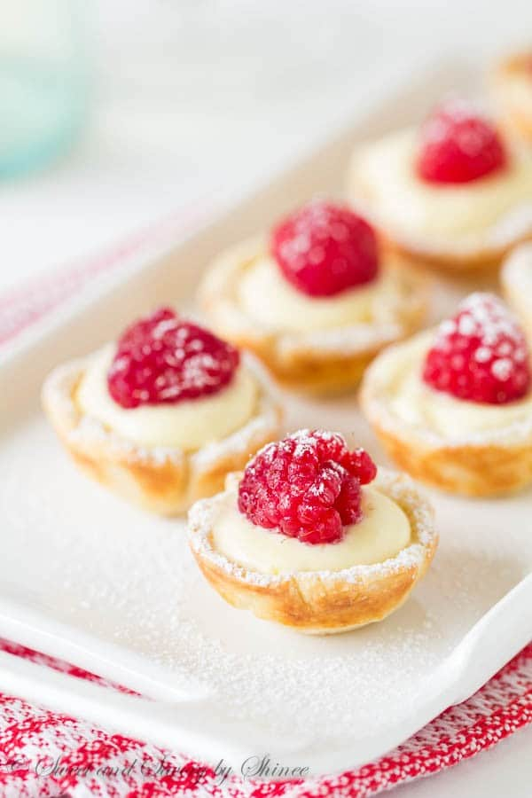 These little flaky tart shells filled with silky smooth lemon cream filling and topped with juicy fresh raspberries are completely from scratch with just 6 ingredients.