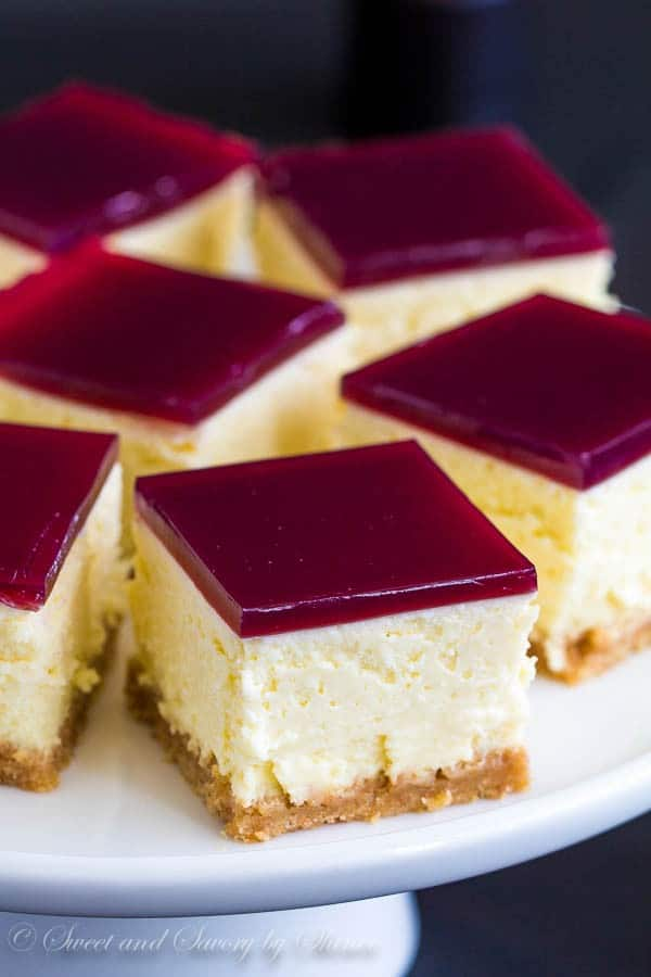 Thick, creamy cheesecake squares topped with a layer of tangy wine gelée. Irresistibly rich and perfect make-ahead dessert!