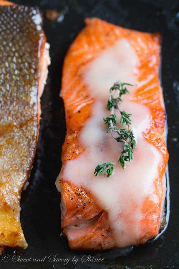 Beautiful pan fried steelhead trout with crispy skin and juicy tender meat, smothered with tangy thyme lemon butter sauce. Delicious dinner in minutes!