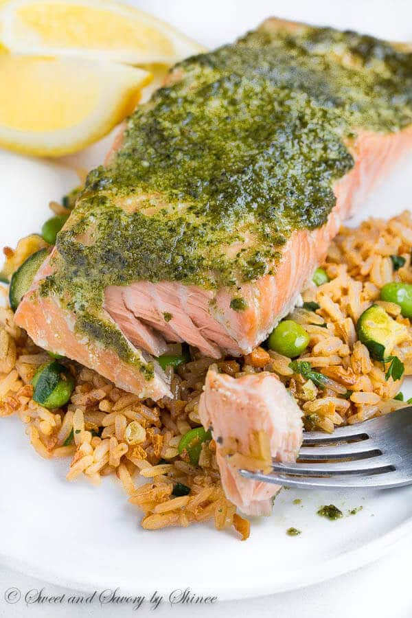 Fool-proof method for delicately tender and juicy baked salmon every time! You'll love melt-in-your-mouth buttery salmon layers infused with flavorful pesto sauce!