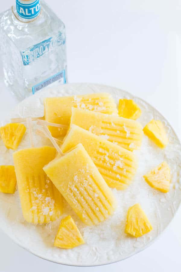 Simple and easy, yet unbelievably satisfying treats for hot summer days! These vibrant and refreshing boozy pineapples ice pops are a must-have for all your summer gatherings.