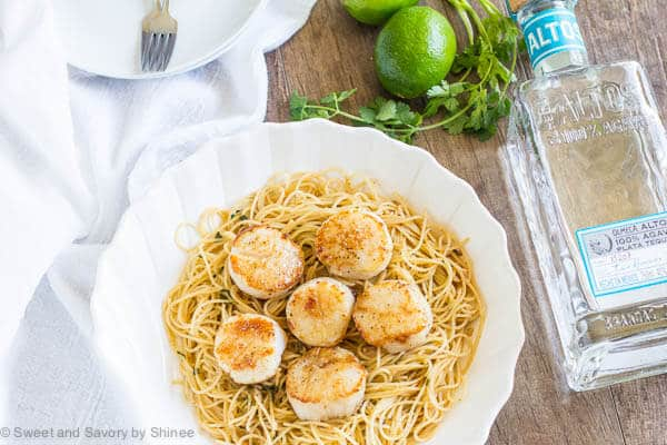 Zesty, buttery tequila lime pasta with seared scallops is a quick and easy dinner for weeknights and beyond. Perfectly seared scallops are easier than you may ever think!