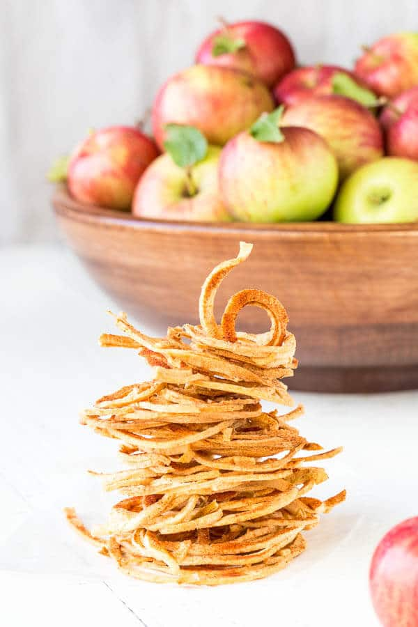 These baked apple strings taste like freeze dried apples. So light and airy, crispy and addicting! And the best part is no special appliance required, just your oven.