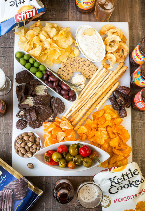 Sweet and salty with a little bit spicy, this snack board is EVERYTHING! Effortless party treat for busy holiday season.