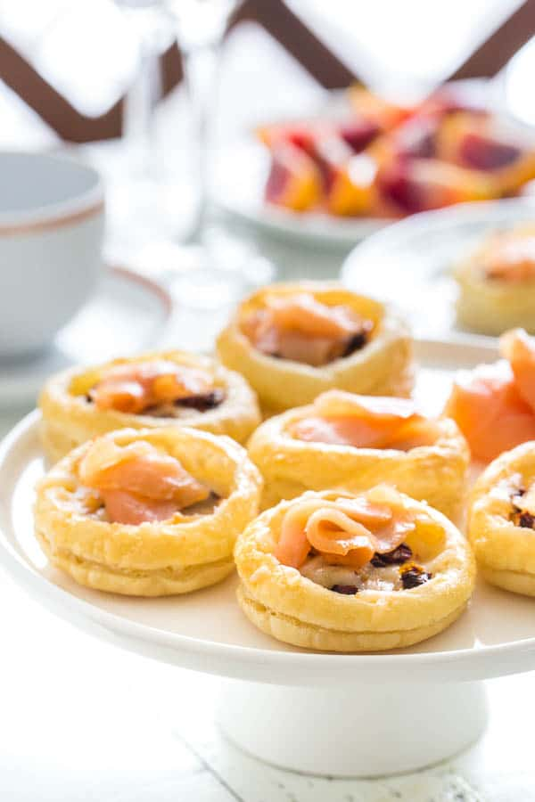 Light n' cheesy, these little brunch tartlets are full of flavor. Sun-dried tomatoes, smoked salmon and ooey gooey mozzarella, all nestled in light and crispy tart shells.