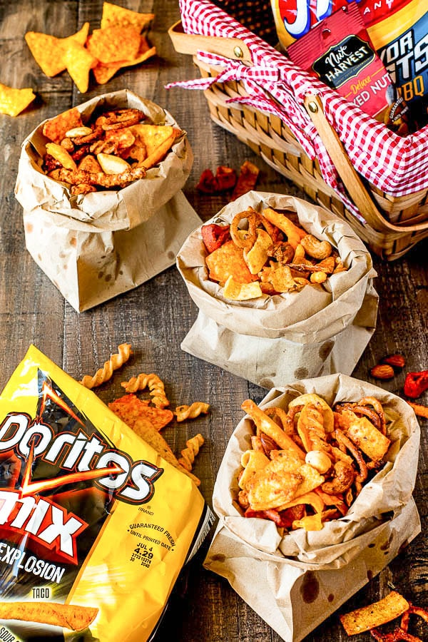 Honey Roasted Spicy Snack Mix! Basically your favorite snacks mixed with honey and butter, tossed with crushed Doritos and baked till crisp perfection! It's really hard to put down a bag full of sweet and spicy snack treats!