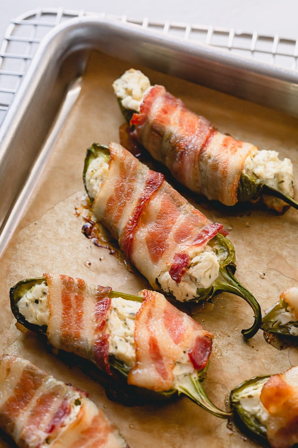 These bacon jalapeno poppers are made with just 3 ingredients and insanely easy to make. Consider yourself warned, because these are dangerously addicting! #jalapenopoppers #baconjalapenopoppers