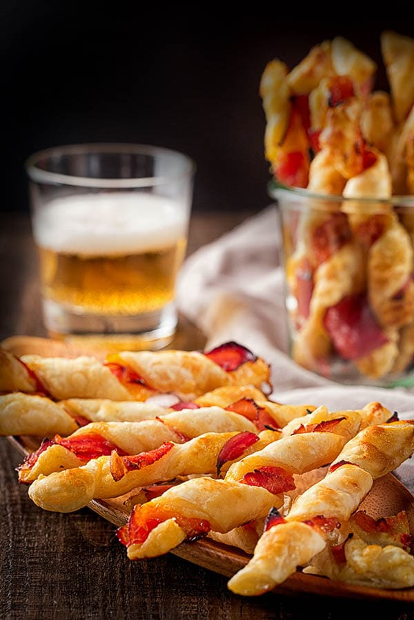 Irresistibly addicting puff pastry twists filled with apricot jam and prosciutto. Perfect little bites of sweet and savory.