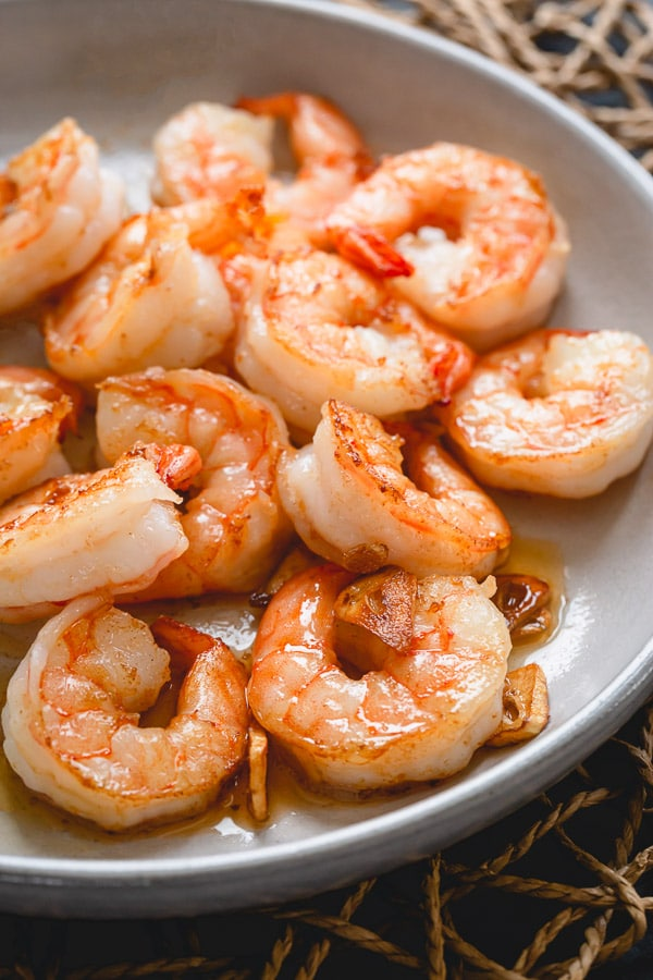 Plump, succulent shrimp sautéed in an aromatic garlic butter - a perfect dinner in minutes. Watch for these visual cues for perfectly cooked soft shrimp!