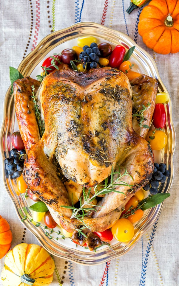 Sharing my secret to super juicy no brine roast turkey recipe that will make you a hero of your Thanksgiving dinner. It involves a bottle of champagne and melted butter! Seriously, unless you want to, you really don't have to brine your bird any more.