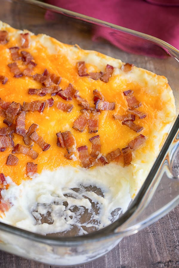 This loaded mashed potato casserole is a perfect make-ahead side dish for a holiday season and feeds an army! Everyone goes for seconds for this one.