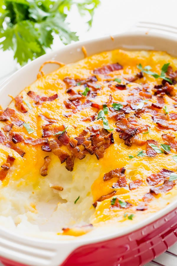 This loaded mashed potato casserole is a perfect make-ahead side dish for a holiday season and feeds an army! Everyone goes for seconds for this one. #mashedpotatocasserole #sidedish #potato #casserole #Thanksgivingsides