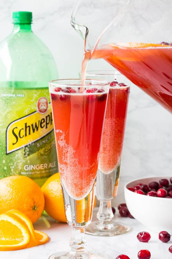 Orange Cranberry Spritzer - deliciously refreshing mocktail with Schweppes® Ginger Ale that's just as fancy as any cocktail. #mocktail #nonalcoholicdrink #partydrink #holidaypunch #spritzer
