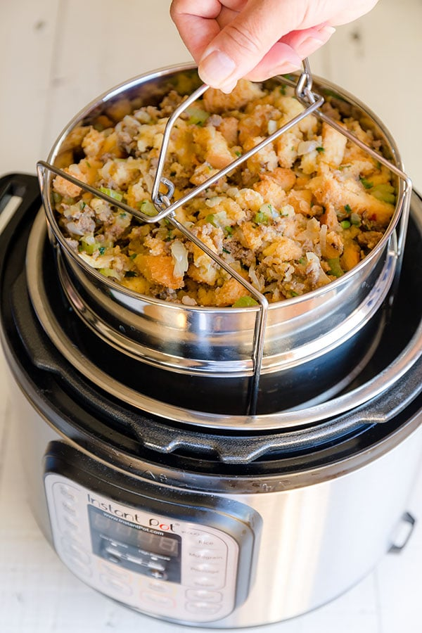 Crazy easy Instant Pot sausage stuffing in less than 1 hour. No more fighting for oven space to make a flavorful stuffing for your Thanksgiving feast! #ThanksgivingMenu #ThanksgivingRecipe #Stuffing #SausageStuffing