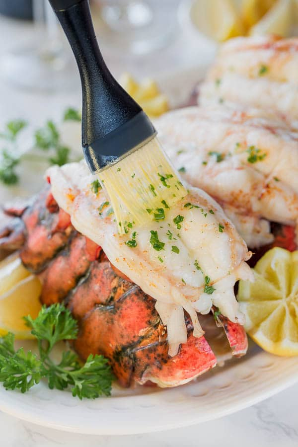 Baked lobster tails are the easiest way to cook lobster tail! Baking in white wine brings out succulent sweet flavors and yields insanely tender meat every time!