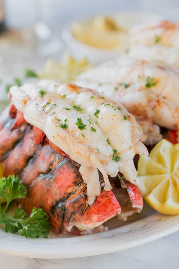 Such an easy way to cook perfect lobster tails. Our family loved it! #lobstertails #bakedlobstertails