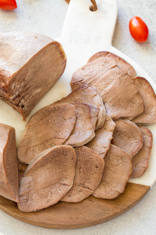 Unbelievably tender and delicious, slow cooked beef tongue makes a delicious appetizer! Learn how to cook beef tongue. #beeftongue #appetizer